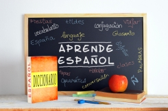 Blackboard in a Spanish classroom. Some books and school stuff for studying Spanish language in a classroom.